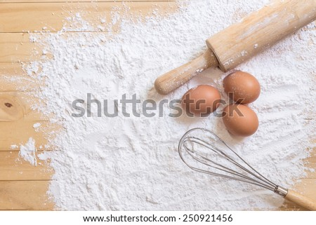 Close up Ingredients for baking cake on wooden deck - stock photo