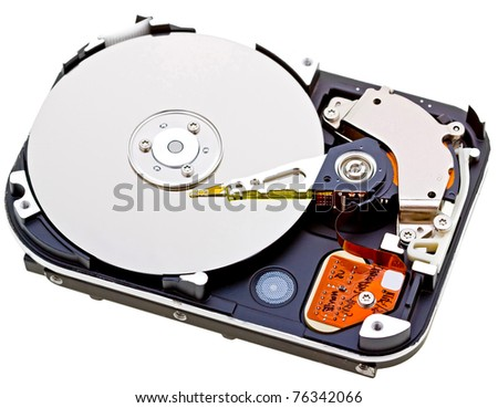 Close-up inside view of  hard disk isolated on white background - stock photo