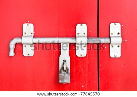 Close up Iron lock on the red door - stock photo