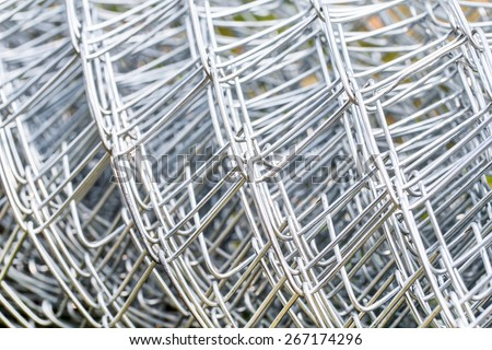 Close up Iron wire fence, Iron wire mesh for background and texture - stock photo