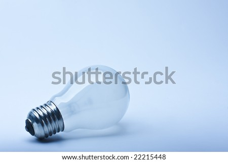 Close-up isolated light bulb in blue lighting