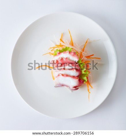 Close up japan style food sashimi from octopus on the white plate - stock photo