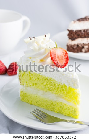 Close up Japanese Matcha Green tea cake decorated with strawberry, berry sweet. - stock photo