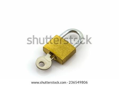 Close up key and lock on white background.  - stock photo
