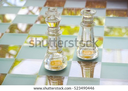 Close Up King and Green on Clear Crystal side of Chess Game on Crystal Board