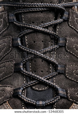 close-up laces on the brown boots - stock photo