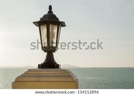 close up lamp post and sea  - stock photo