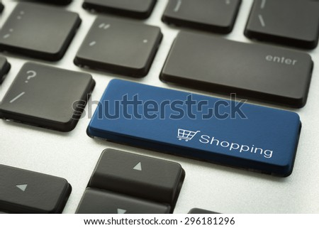 Close up laptop keyboard focus on a blue button with typographic word SHOPPING. E-commerce and digital marketing concepts. - stock photo