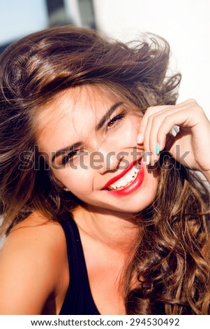 Close-up lifestyle portrait of Young pretty teen girl with perfect skin stylish hairstyle,posing on urban background,bright summer fashion portrait.Smiley face,amazing smile,sensual,accessories,bright - stock photo