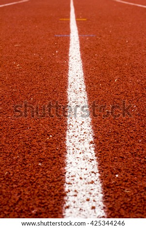 Close up line curve rubber running track standard. Soft focus