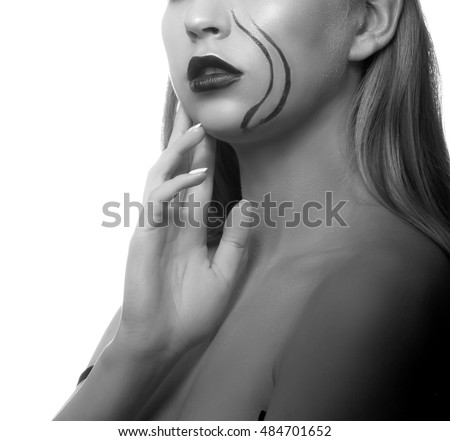 Close-up lips and shoulders of sexy girl with creative face art isolated on white background. Studio portrait. Black and white