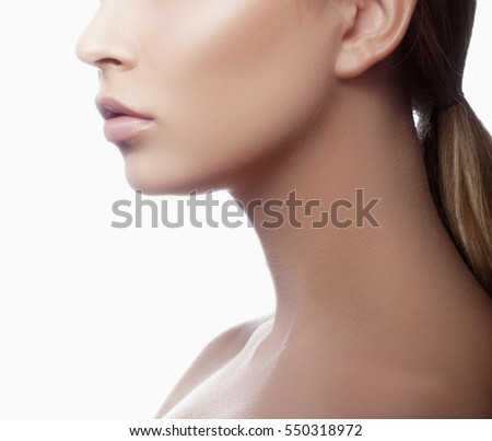 Close-up lips and shoulders of young caucasian girl with natural makeup profile. Woman portrait.