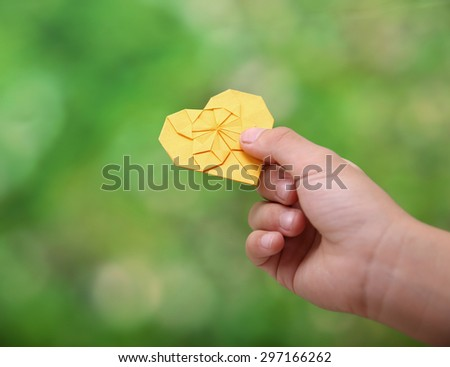 close-up little boy holding paper heart - stock photo