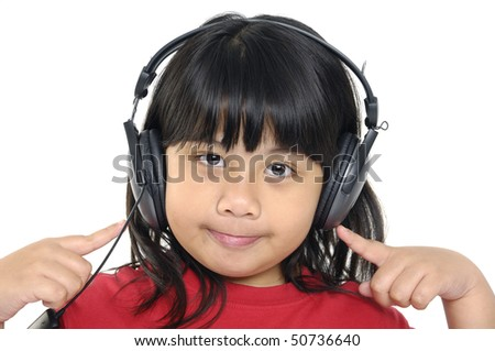 Close up little girl listening music