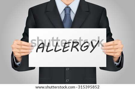 close-up look at businessman holding allergy poster - stock photo