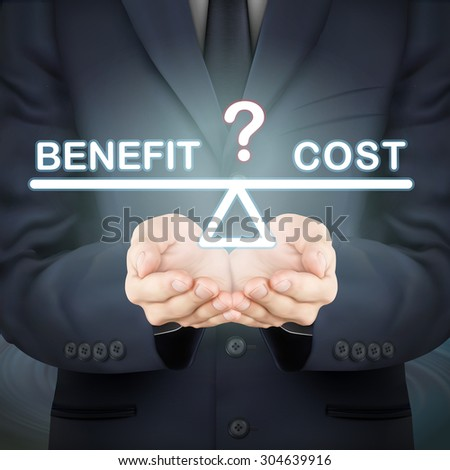 close-up look at businessman holding benefit and cost seesaw - stock photo
