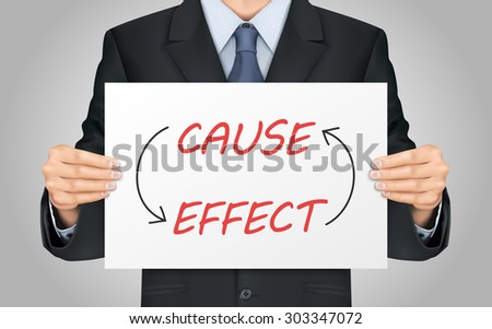 close-up look at businessman holding cause and effect poster - stock photo
