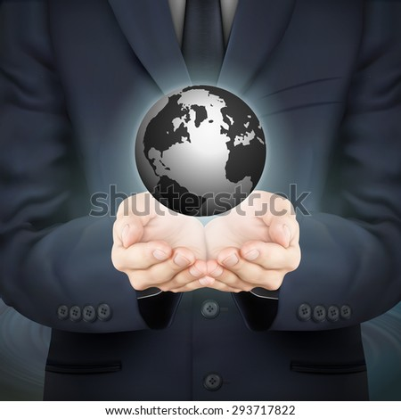 close-up look at businessman holding globe symbol