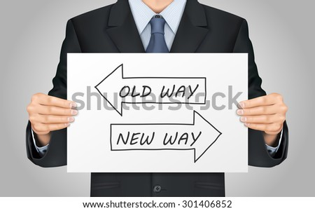 close-up look at businessman holding old way or new way poster - stock photo