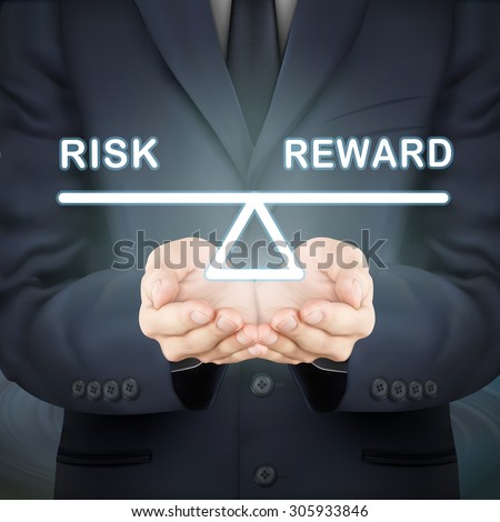 close-up look at businessman holding risk and reward seesaw - stock photo