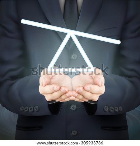 close-up look at businessman holding seesaw icon - stock photo