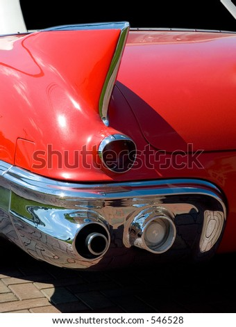 Close-up look at the rear fender design of a classic car. - stock photo