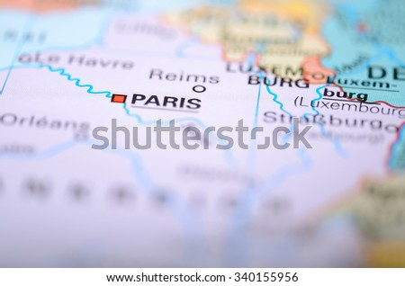 Close-up macro image of map France .Selective focus on Paris - stock photo