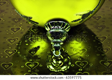 Close up macro of a green christmas bauble reflecting on the background - stock photo