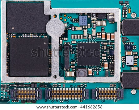Close up / macro of a mobile phone printed circuit board with electronic components - stock photo
