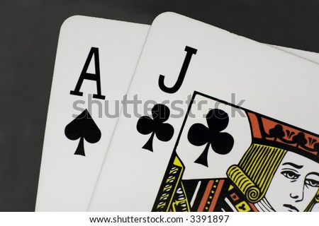 """Close up / macro of a pair of cards adding up to 21 or """"Black Jack"""" - stock photo"""