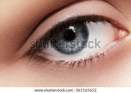 Close-up macro of beautiful female eye. Clean skin, fashion naturel make-up. Good vision - stock photo