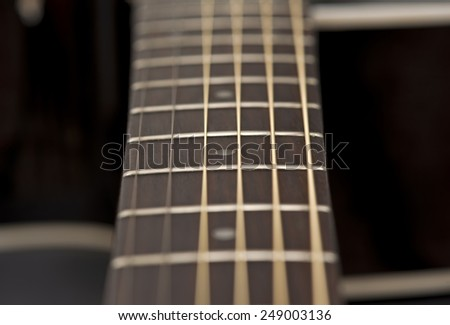 close-up macro of guitar strings and fret board - stock photo