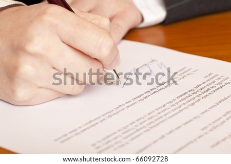 Close-up macro of signing a contract. - stock photo