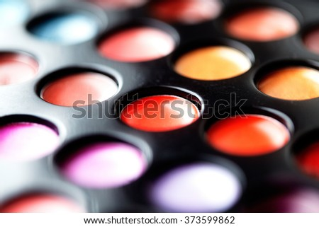 Close-up macro shot of lipgloss palette. Colourful salon cosmetics for makeup artist. Vibrant make-up product. Soft focus  - stock photo