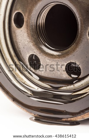 Close up macro used car oil filter - stock photo