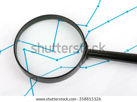 Close up magnifying glass on paper with the schedule - stock photo