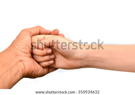 close up male and female hands holding together - stock photo