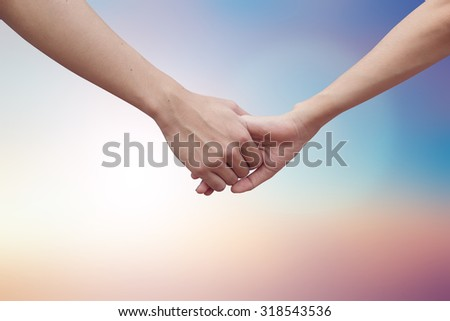 close up male and female hands holding together on blurred pastel background.passion in love concept ,soft focused.picture use for work about decorate,design.happy family concept.healthcare family. - stock photo