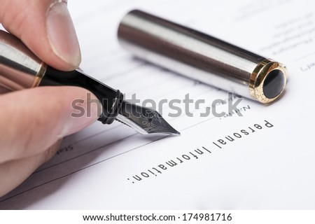 Close up man hand fiil up personal infomation form - stock photo