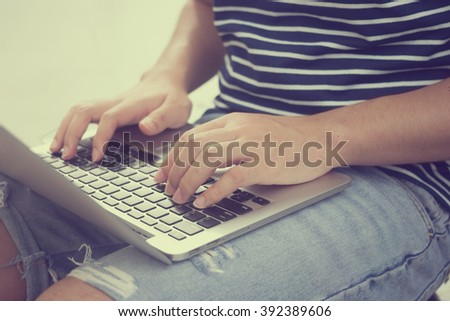 close up man hand typing on laptop for update email news daily:student thinking and text headline topic for newspaper public concept:freelance working at notebook:image vintage tone filter effect - stock photo