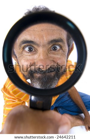 Close Up - Man holding a magnifying glass  . - stock photo