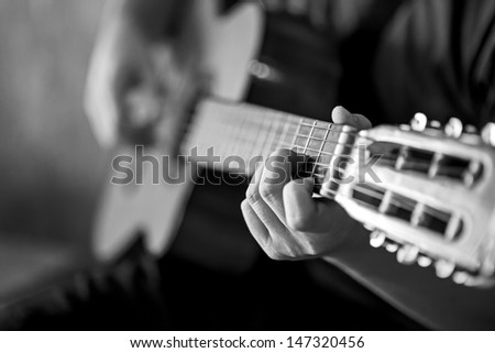 Close-up man playing  acoustic guitar - stock photo