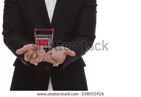 Close-up man's hands holding a shopping cart. - stock photo