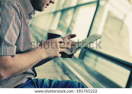 close up man's hands with tablet