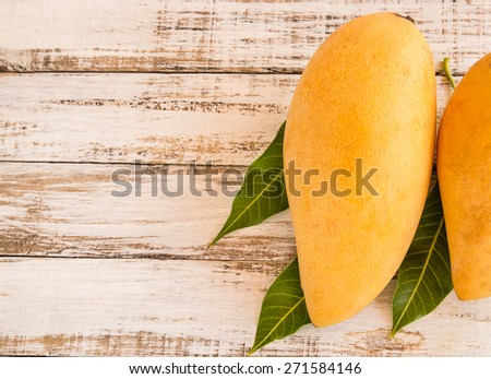 Close up mango ripe on a wooden background - stock photo