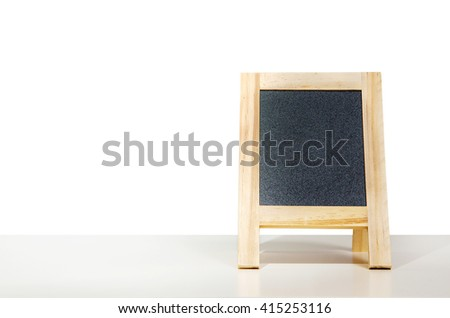 Close up menu Black Board on table with Isolated. - stock photo