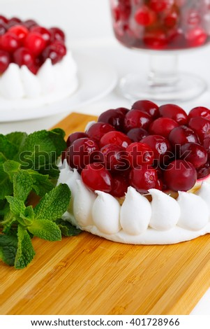 Close up meringue cake with cream and cranberries.  - stock photo
