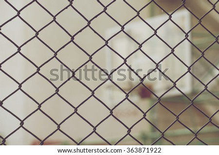 Close up metal net with blur basketball hoop in vintage style.