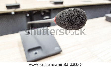 Close up microphone in conference room. selective focus over the blurred photo of conference hall or seminar room background.