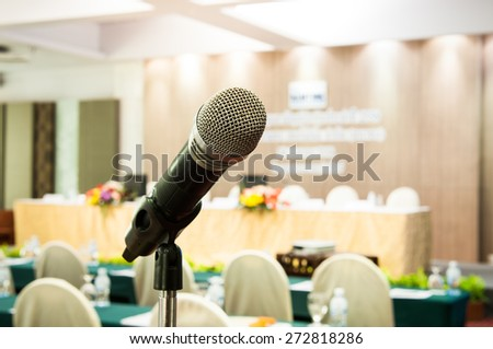 close-up microphone in seminar room. - stock photo